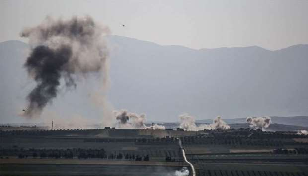 Smoke billows following reported shelling around the village of al-Muntar on the southern edges of t