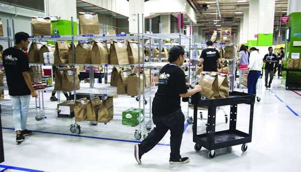 Employees prepare orders for shipping at an Amazon Prime Now fulfilment centre in Singapore.