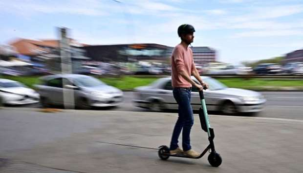 A man rides an E-Scooter  in Berlin