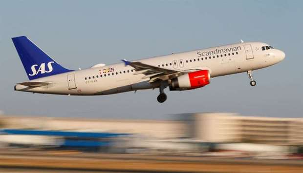 A Scandanavian Airlines, known as SAS, aeroplane takes off from the airport in Palma de Mallorca, Sp