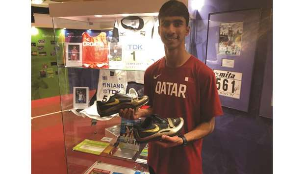 Phillips donates spikes to IAAF Heritage Collection