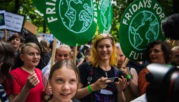 "Greta Thunberg (C), the 16-year-old Swedish climate activist, marches during the ""Global Strike For"