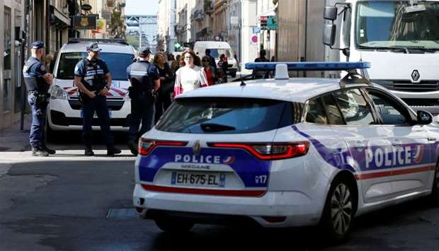Police patrol the streets during the manhunt of a suspected suitcase bomber in central Lyon