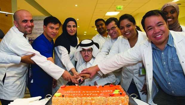Abdulrahman Shahin al-Neimi and members of his care team.