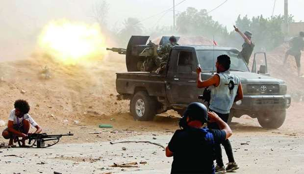 A fighter loyal to the Libyan internationally-recognised Government of National Accord (GNA) fires a