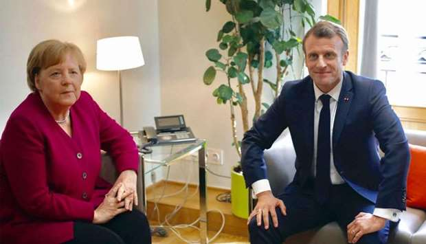 German Chancellor Angela Merkel (L) meets with French President Emmanuel Macron