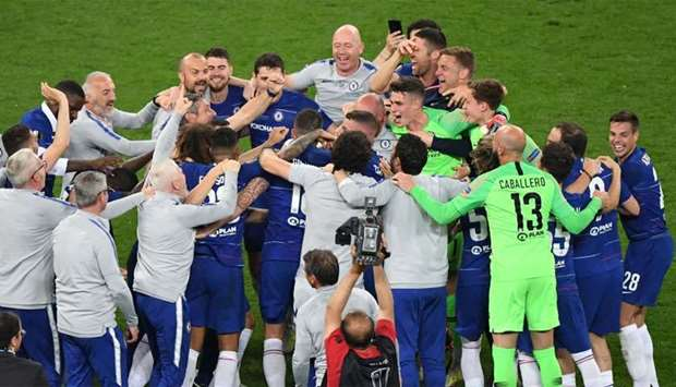 Chelsea's players celebrate after the final whistle of the UEFA Europa League final football match b