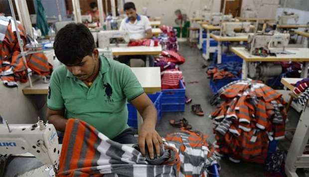 Indian men work at a garment factory in Ludhiana. India's economy grew at a much-lower-than-expected