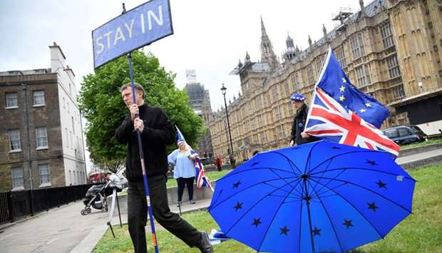 Anti-Brexit protesters are seen near the Houses of Parliament in London