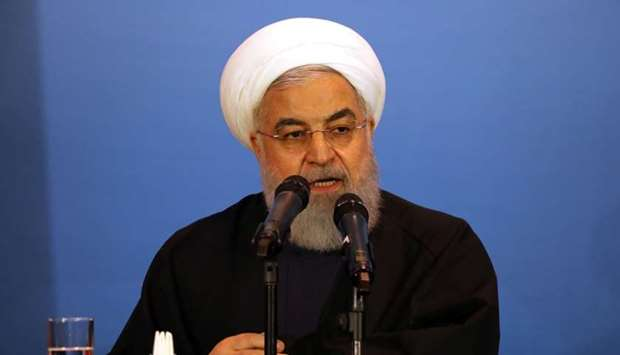 Iranian President Hassan Rouhani speaks during a meeting with tribal leaders in Kerbala, Iraq