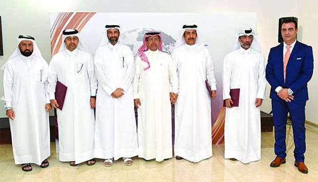 Sheikh Dr Faleh bin Nasser al-Thani and other MME officials with the representative of the organisat