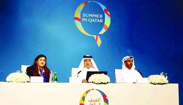 (From left) Salam al-Shawa, HE Akbar al-Baker, and Rashed al-Qurese at the press conference announci