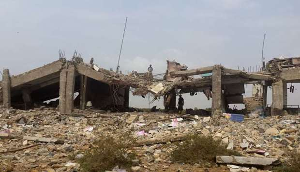 A destroyed building is pictured in the area of Yemen's northern coastal town of Midi