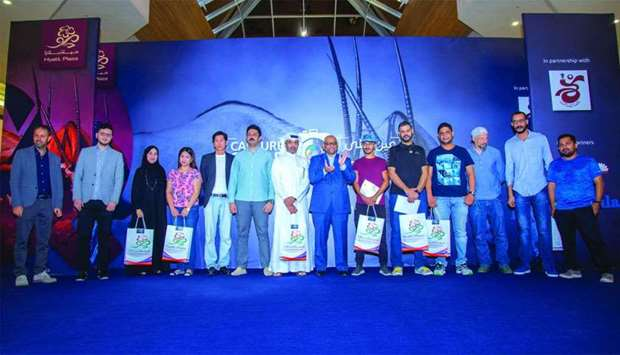 "Top winners of ""Capture Qatar"" photo contest after receiving their awards."