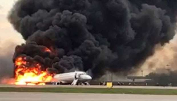 A passenger plane is seen on fire after an emergency landing at the Sheremetyevo Airport outside Mos
