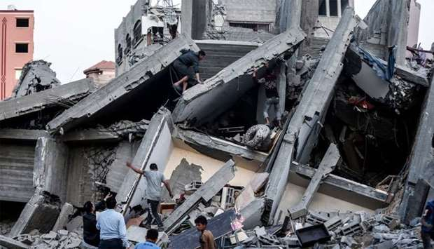 Remains of a building in Gaza City after it was hit during Israeli air strikes