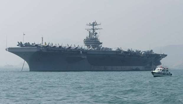 In this file photo taken on December 23, 2004 A small boat sails by the USS Abraham Lincoln moored i