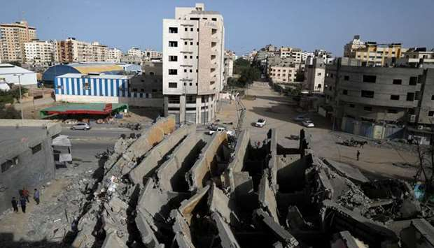 A view shows the remains of a building that was destroyed by Israeli air strikes, in Gaza City