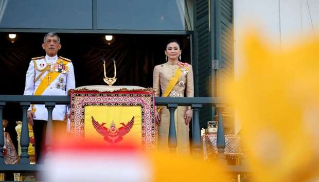 Thailand's newly crowned King Maha Vajiralongkorn and Queen Suthida are seen outside the balcony of
