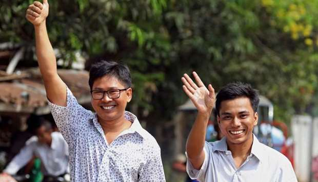 Reuters journalists Wa Lone (L) and Kyaw Soe Oo gesture as they walk to Insein prison gate after bei