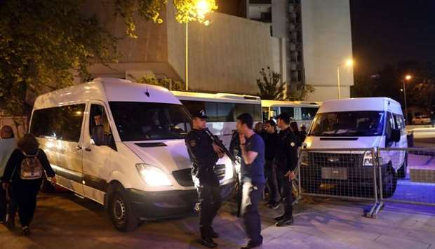 Turkish riot police guard the headquarters of the Supreme Electoral Council, the highest electoral a