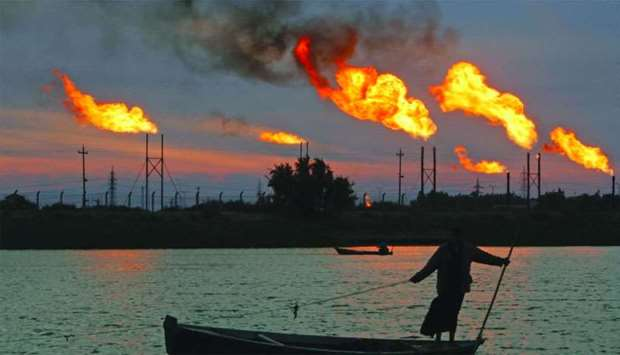 Flames emerge from flare stacks at the oil fields in Basra, Iraq