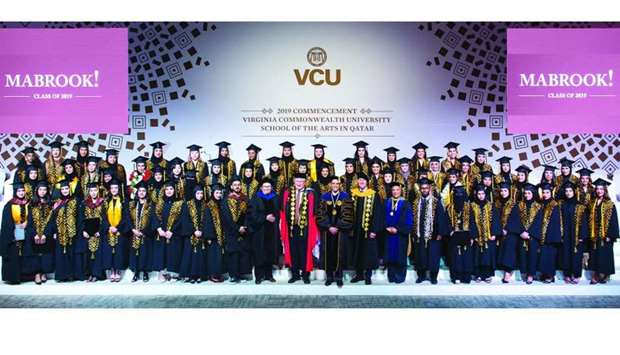 VCUarts Qatar graduates with officials at the ceremony.