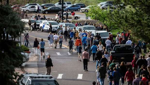Students are evacuated from the Recreation Center at Northridge in Highlands Ranch after a shooting