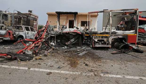 Damaged vehicles are seen at Tripoli's Mitiga airport after it was hit by shelling in Tripoli
