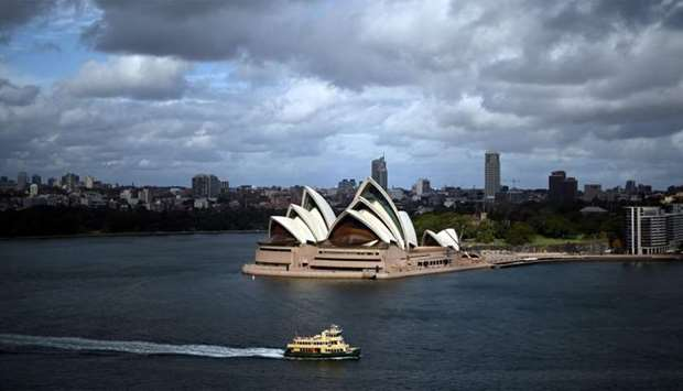 A ferry sails before the Opera House in Sydney harbour