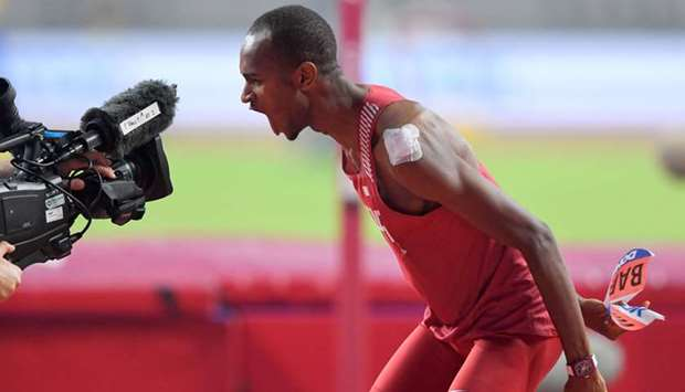 Qatar's Mutaz Barshim celebrates winning his gold medal in the men's high jump event at the Doha Wor