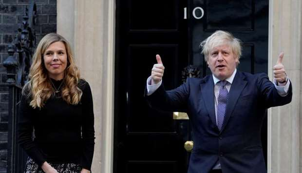 Britain's Prime Minister Boris Johnson and his partner Carrie Symonds applaud outside 10 Downing Str