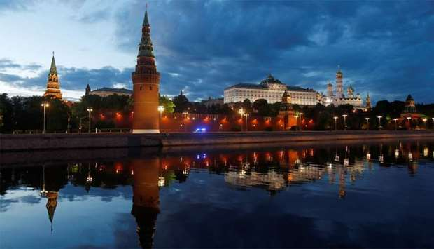 An ambulance moves past Kremlin as the spread of the coronavirus disease (COVID-19) continues in Mos