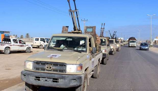 Military vehicles of the Libyan internationally recognised government forces head out to the front l