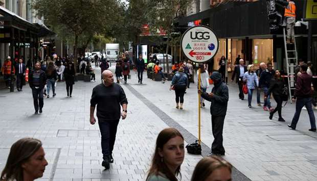 Increased foot traffic is seen in the city centre following the easing of restrictions implemented t