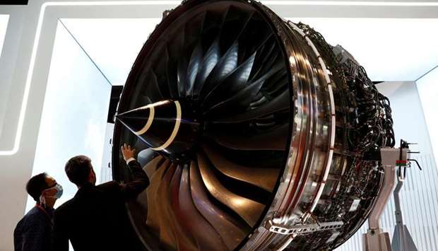 A man looks at Rolls Royce's Trent Engine