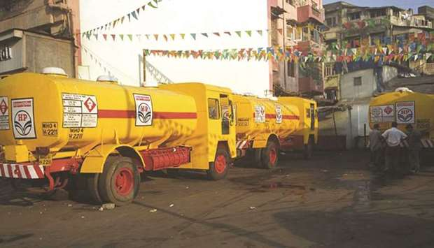 A Hindustan Petroleum tanker delivers fuel to a petrol pump in central Mumbai. Once the engine of gl