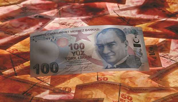 A 100 Turkish lira banknote is seen on top of 50 lira banknotes in this picture illustration in Ista