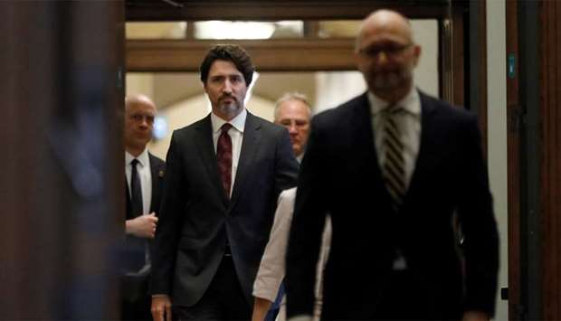 Canada's Prime Minister Justin Trudeau arrives with government ministers