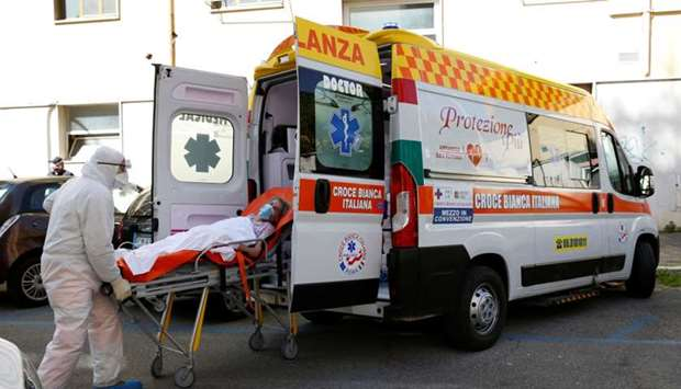 A patient is carried on a stretcher from a nursing home to a hospital, as the spread of the coronavi