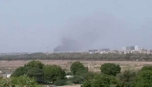 A plume of smoke is seen after the crash of a PIA aircraft in Karachi, Pakistan