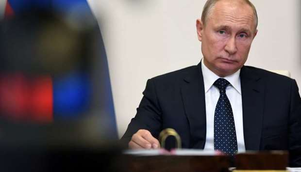 Russian President Vladimir Putin attends a meeting of the Supreme Eurasian Economic Council via vide