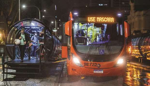 View of a public bus with an electronic sign reading 'Wear a face mask', in Curitiba, Brazil.