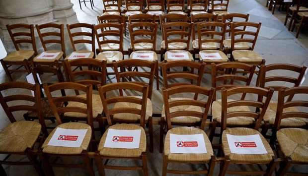 Signs are placed indicating to worshippers not to sit on certain seats at the Saint Germain l'Auxerr