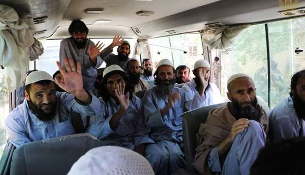 Afghanistan's (NCS) National Security Council, Taliban prisoners wave inside a vehicle during his re