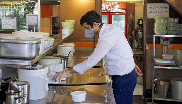 Iran eases restaurant curbs as virus claims 57 more lives
