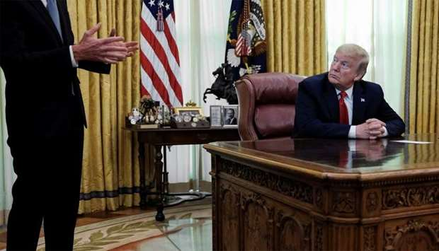 US President Donald Trump listens to Gilead Sciences CEO Daniel O'Day speak about the use of the com