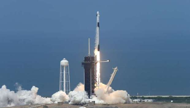 A SpaceX Falcon 9 rocket and Crew Dragon spacecraft carrying NASA astronauts Douglas Hurley and Robe