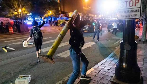 Protesters face off with police during rioting and protests in Atlanta on Friday night.