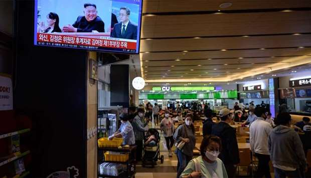 A television screen shows a news broadcast with an image of North Korea's leader Kim Jong Un at a se